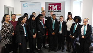 Managing Director with Manchester Communication Academy Students & Charity representatives.
